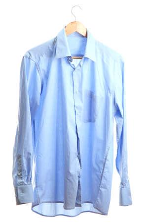 blue shirt on wooden hanger isolated on white Stock Photo - 15150358