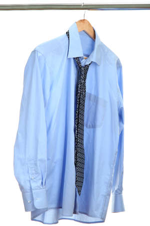 blue shirt with tie on wooden hanger isolated on white Stock Photo - 15150597