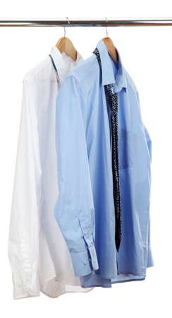 blue and white shirts with tie on wooden hanger isolated on white photo
