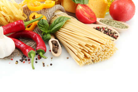 Pasta spaghetti, vegetables and spices, isolated on white Stock Photo - 15151583