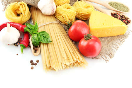 Pasta spaghetti, vegetables and spices, isolated on white Stock Photo - 15151895