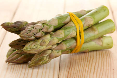 nutritiously: Useful asparagus close-up on wooden table on white background Stock Photo