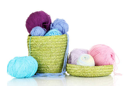yarn: Colorful yarn for knitting in green basket isolated on white
