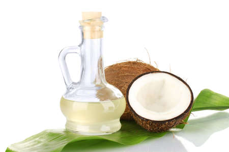 decanter with coconut oil and coconuts isolated on white Stock Photo - 15149561