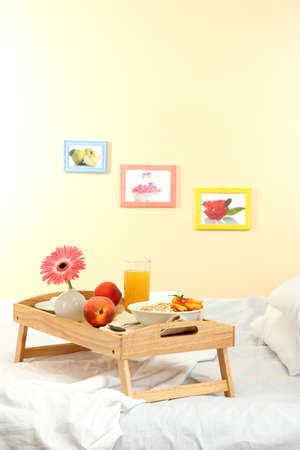 wooden tray with light breakfast on bed Stock Photo - 15151471
