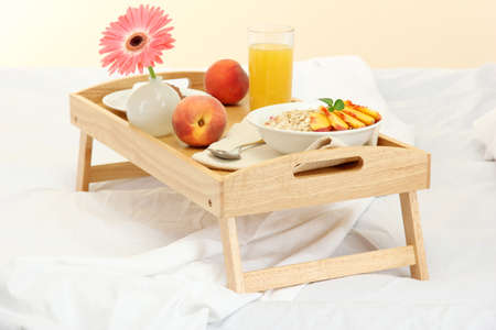 wooden tray with light breakfast on bed Stock Photo - 15151636
