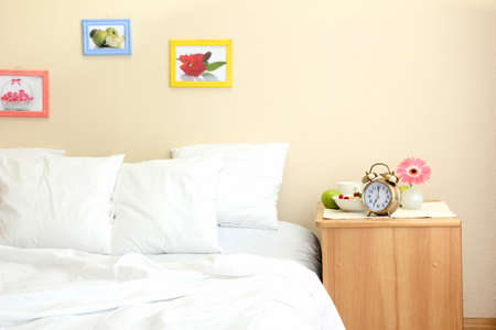 light breakfast on the nightstand next to the bed Stock Photo - 15152127
