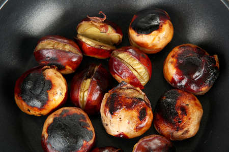 buckeye seed: roasted chestnuts in the pan close-up