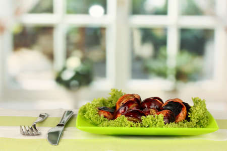 roasted chestnuts with lettuce in the plate on the tablecloth close-up Stock Photo - 15152128