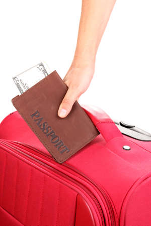 holding passport and suitcase in hand close-up Stock Photo - 15153243