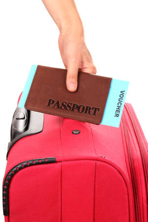 holding passport and suitcase in hand close-up Stock Photo - 15153240
