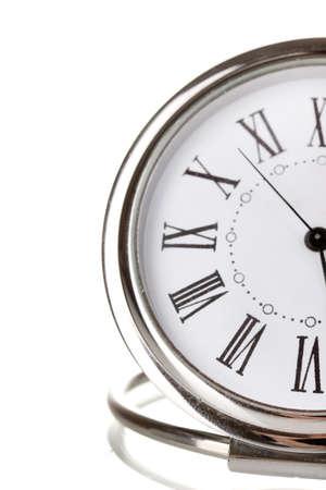 Clock close-up isolated on white photo