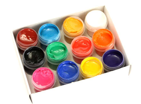 gamma: jars with colorful gouache in paper box on white background close-up