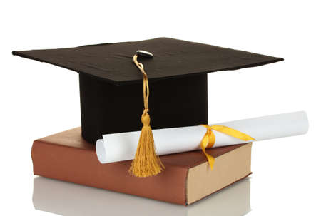 Grad hat and diploma with book isolated on white photo
