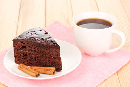 Chocolate sacher cake on wooden table photo