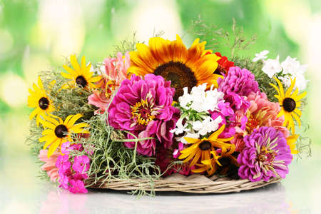 Beautiful bouquet of bright flowers on nature background photo