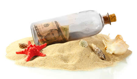 Glass bottle with note inside on sand isolated on white Stock Photo - 15505813