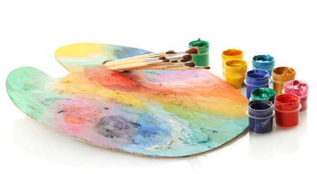 wooden art palette with paint and brushes isolated on white Stock Photo - 15505756