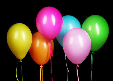 colorful balloons isolated on black background photo