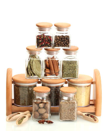 jars and wooden with spices isolated on white photo