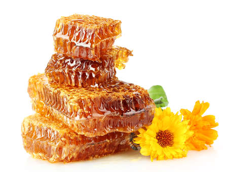 sweet honeycomb with honey, bee and flowers, isolated on white photo