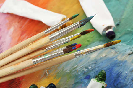 acrylic paint, paint tubes and brushes on wooden palette Stock Photo - 15283085