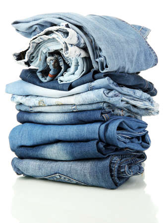 Lot of different blue jeans isolated on white Stock Photo - 15276127
