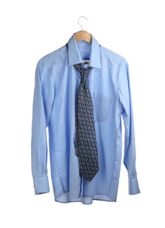 blue shirt with tie on wooden hanger isolated on white photo