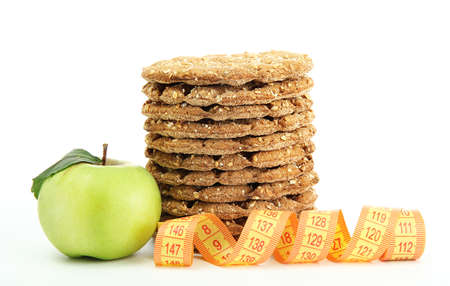 tasty crispbread, apple and measuring tape, isolated on white Stock Photo - 15282837