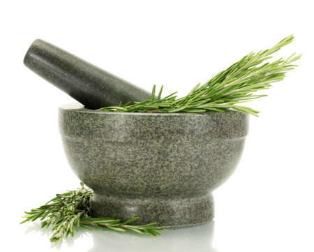 mortar with fresh green  rosemary isolated on white photo