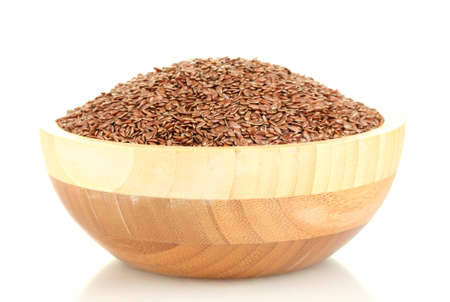 flax seeds in wooden bowl isolated on white background photo