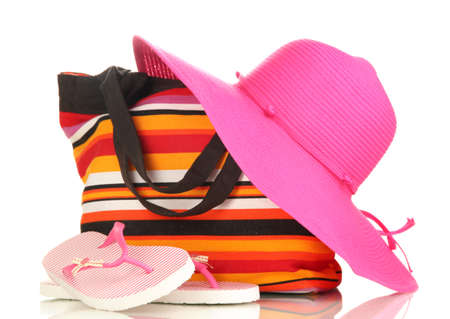 accessory: Beach bag with accessories isolated on white Stock Photo