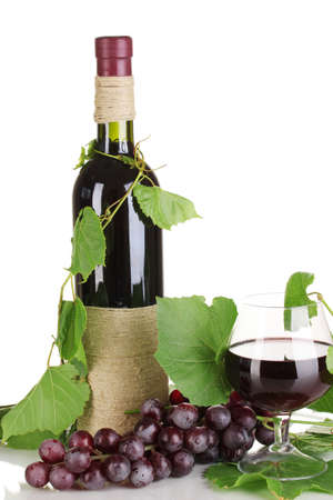 bottle of wine with grape leaves isolated on white photo