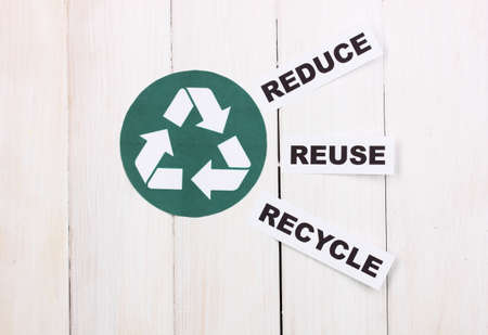 protect concept: Recycling sign on wooden background