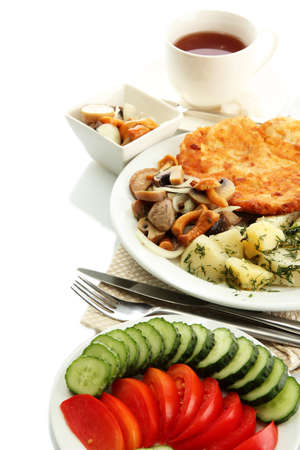 Roast chicken cutlet with boiled potatoes and mushrooms, cup of tea isolated on white photo