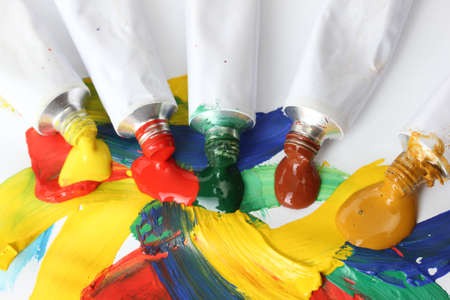 Abstract acrylic paint and paint tubes isolated on white photo