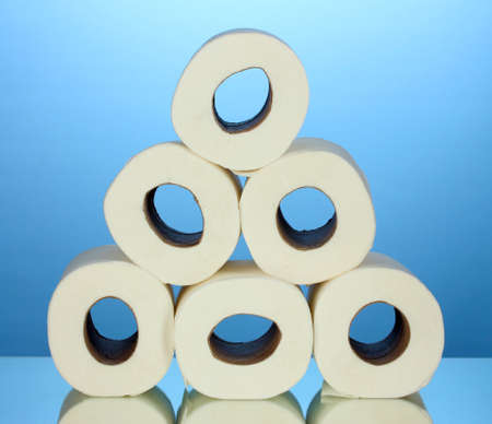 rolls of toilet paper on blue background photo