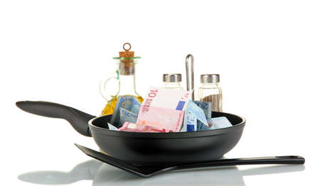 Banknotes in a frying pan with cooking spatula isolated on white Stock Photo - 15410727