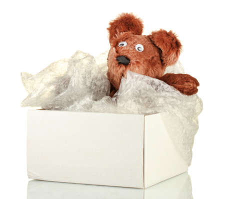 Opened parcel with a childs toy isolated on white photo