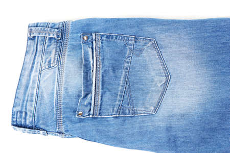 Fashion blue jeans close-up isolated on white photo