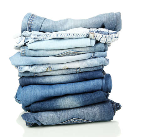 Lot of different blue jeans isolated on white Stock Photo - 15385979
