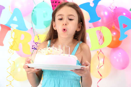 happines: Little beautiful girl celebrate her birthday