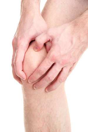 sore joints: man holding sore knee, isolated on white Stock Photo