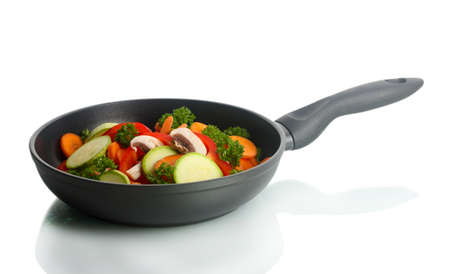 dripping pan: frying pan with vegetables on white Stock Photo