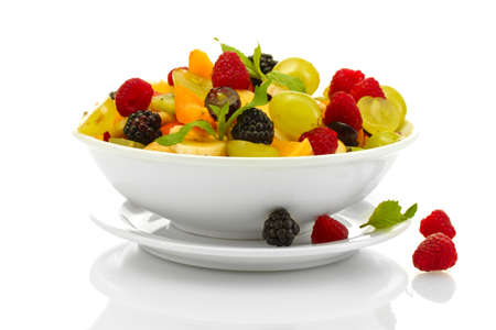fresh fruits salad in bowl  and berries, isolated on white photo