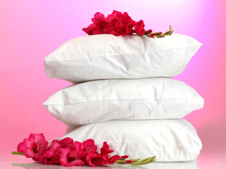 pillows and flower, on pink background photo