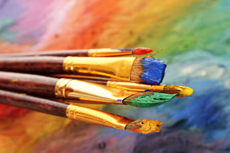 acrylic paint and brushes on wooden palette Stock Photo - 15520391