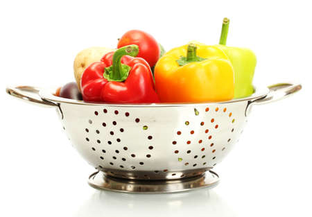 a colander: fresh vegetables in silver colander isolated on white