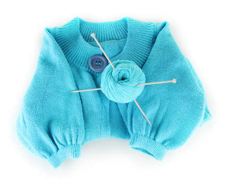 Blue sweater and a ball of wool isolated on white photo