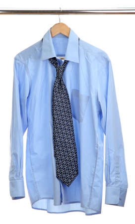 blue shirt with tie on wooden hanger isolated on white Stock Photo - 15519844
